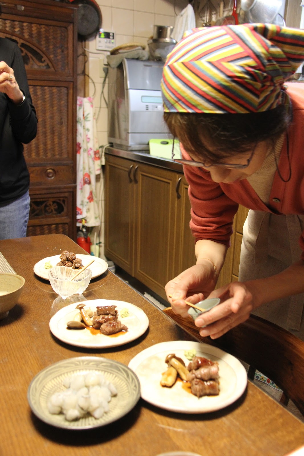 uzuki japanese homestyle cooking classes in kyoto kitchen table cooking school of hours cooking together learning about seasonal cuisine and the wonders of Kyoto before enjoying a meal around the kitchen table sampling our wares