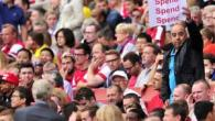 An Arsenal fan makes his feeling clear during Saturday's defeat to Aston Villa.