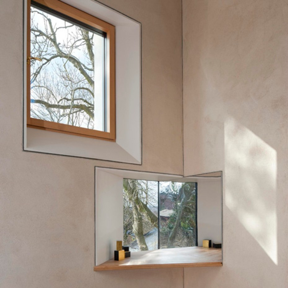 Two small windows in the Long room of zero carbon house Birmingham