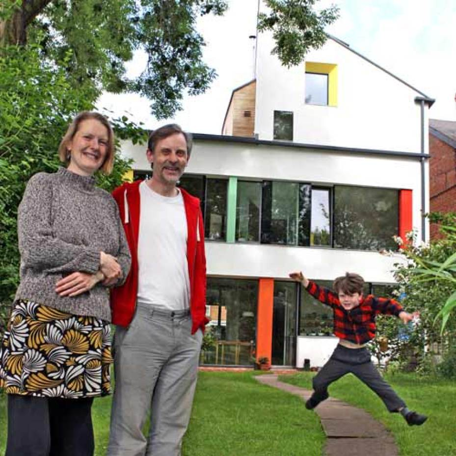 Christophers family in the back garden of zero carbon house, Birmingham
