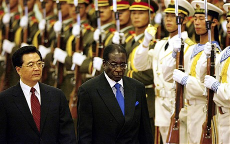 Robert Mugabe meets with Xi Jinping in China to shake on Zimbabwe cash injection