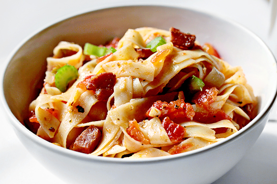 Pasta With Bacon And Tomato Sauce step by step recipe with pictures, bacon, celery and chopped tomato in a large frying pan or skilled, dried tagliatelle in a bowl