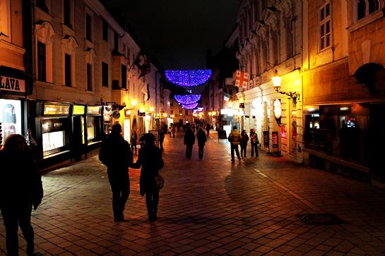 Christmas market street at night with Christmas lights