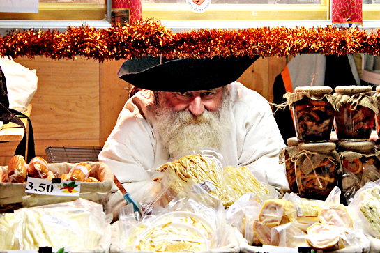 Christmas market man selling cheese products
