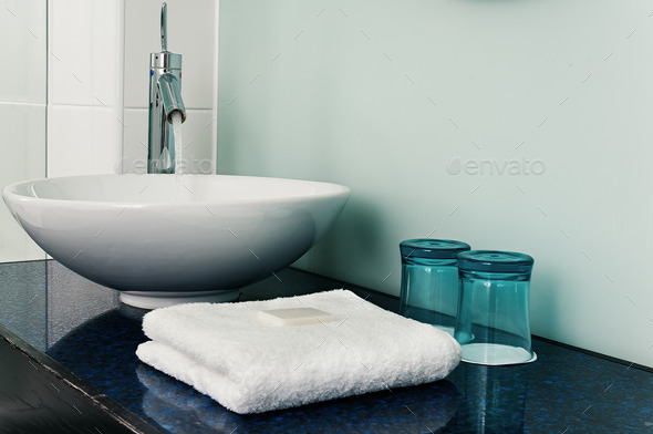 bathroom sink counter towels water