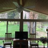 INSIDE VIEW OF AN ALL SEASON VINYL SUNROOM WITH GABLE STYLE ROOF BY BETTERLIVING SUNROOMS & AWNINGS OF PITTSBURGH