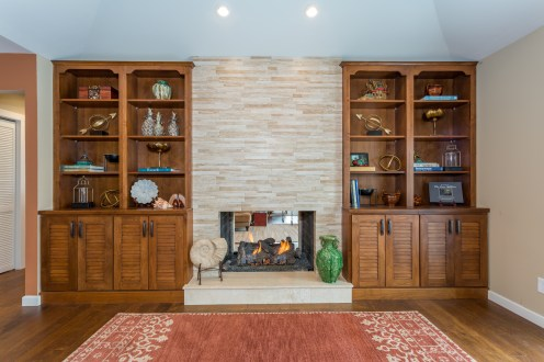 Travertine fireplace with Bertch Cabinetry