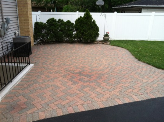 Before Photo of Driveway with Multi-Colored Stones