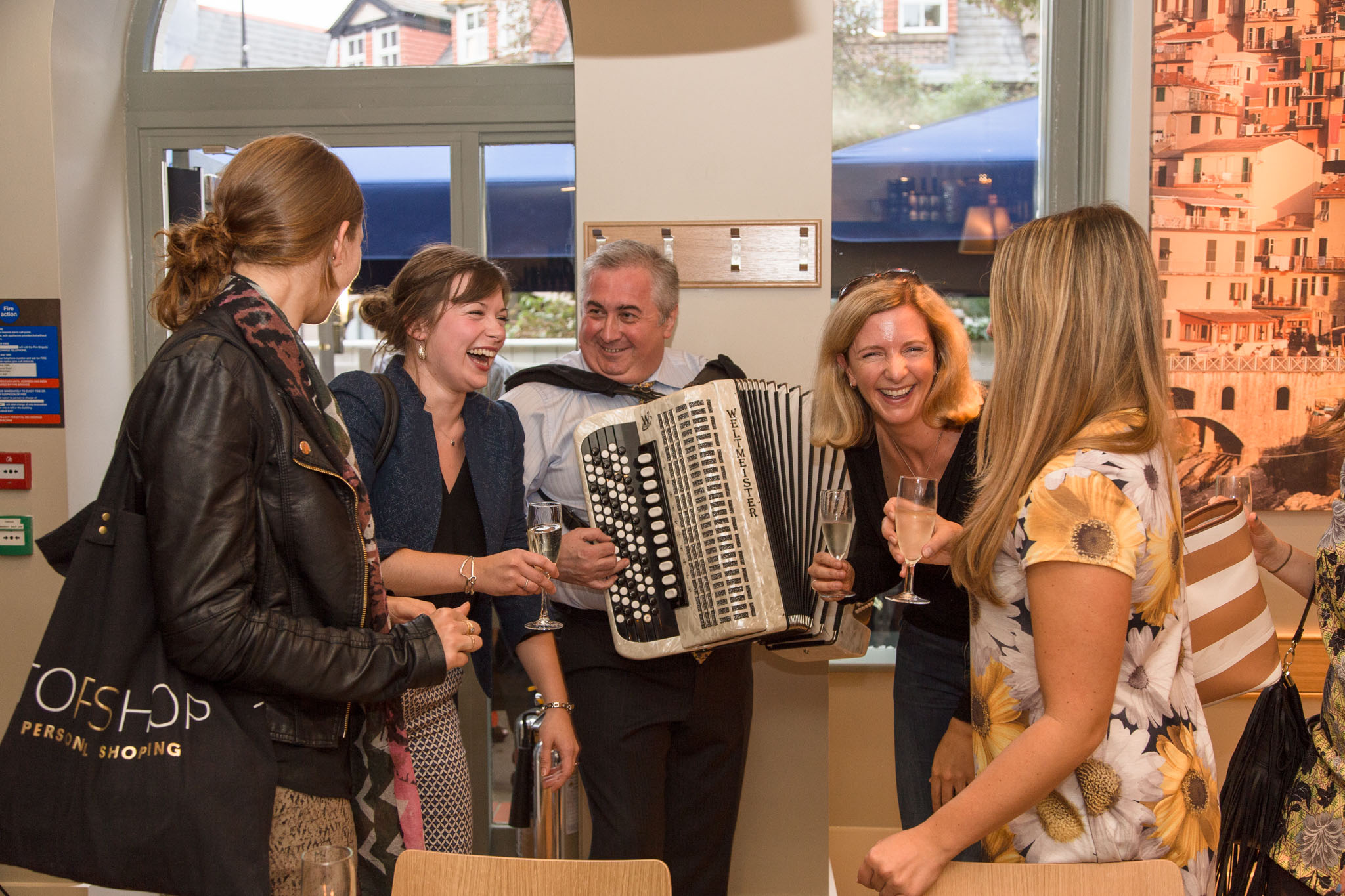 Special Event Photography Carluccio's opening with guests enjoy music