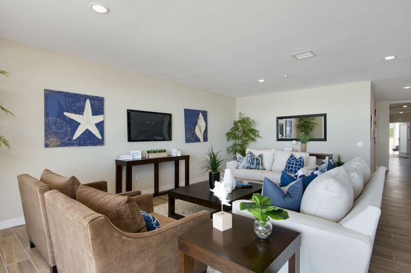 Living room staging with white, beige and blue accents