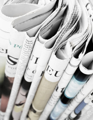 stock-photo-75047219-pile-of-newspapers-selective-focus