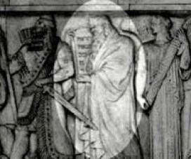 Moses holding an inscribed tablet, is in the middle.