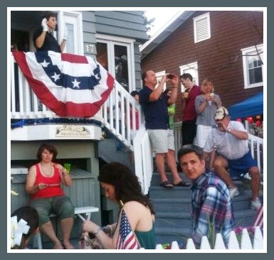 Soundview Drive is one place to be for the fireworks. The woman on the balcony is conducting a fife and drum corps, which entertained along the closed-to-traffic road.