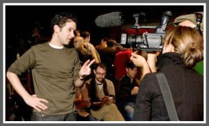 """Ari Edelson, doing an interview for """"24-Hour Musicals."""" (Photo by Kerry Long)"""