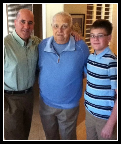 Ken Brummel this past Thanksgiving. He is flanked by his son Peter, and grandson Owen.