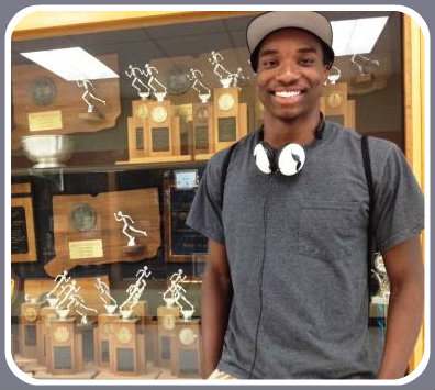 Malik Brantley a few days before graduation, in front of the Staples track trophy case.