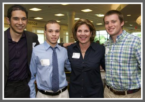 (From left) Juan Castro, Justin Jones and Trevor Lally join Staples Tuition Grants co-chair Diana Bowes Weller.