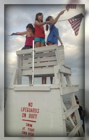 Every kid wants to climb the lifeguard stand. The flags are an added attraction.