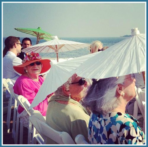 Guests with parasols, hoping for a breeze. (Photo by Betsy P. Kahn)