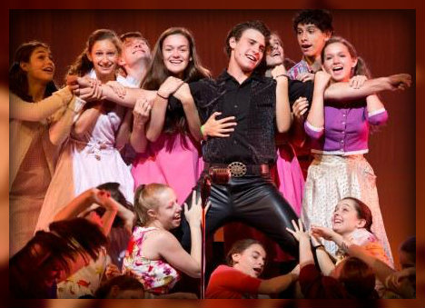 Jack Seigenthaler (as Conrad Birdie) is surrounded by adoring fans. (Photo by Kerry Long)