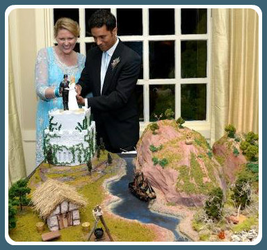 "Kerstin and Vijay cut the cake. They created the ""Princess Bride"" tableau themselves. (Photo/Pam Einarsen)"