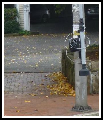 A camera on a Main Street traffic pole, near Vineyard Vines. (Photo/Peter Hannan)