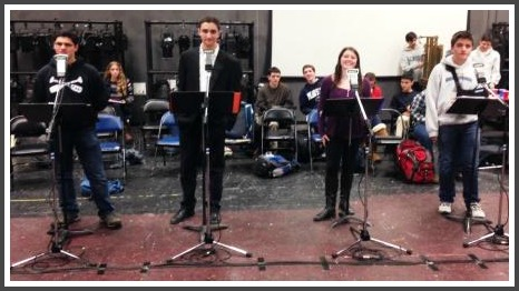 "Rehearsing ""A Christmas Carol,"" in front of the microphones."
