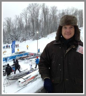 John Vester at Lake Placid yesterday. The US sled is visible underneath his arm.