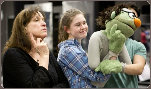 """Pam Arciero (left) coaches Rachel Corbally on being a right hand to """"Nicky,"""" the puppet. (Photo/Kerry Long)"""
