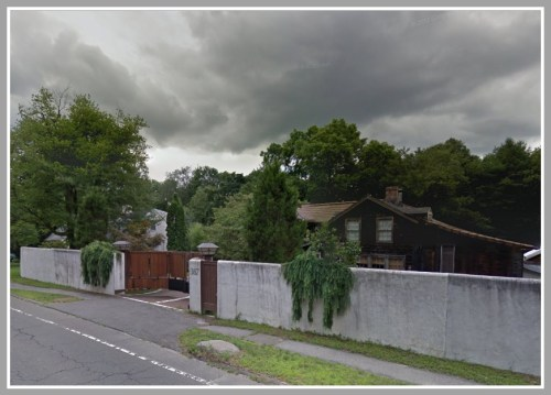 David Royce's house on Main Street, at the foot of Cross Highway. For decades, Westporters wondered what was behind that wall.