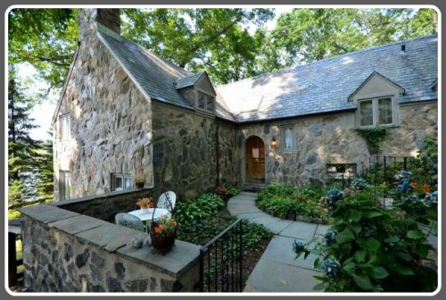 This Frazier Forman Peters house on Riverview Road features The exterior to the Tudor cottage at 9 River View Road features fieldstone facades, slate roof and copper gutters.