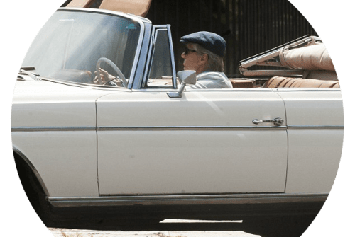 Michael Douglas driving Bill Scheffler's Mercedes.