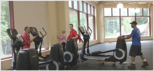 Cardio machines are delivered to the Robin Tauck Wellness Center.