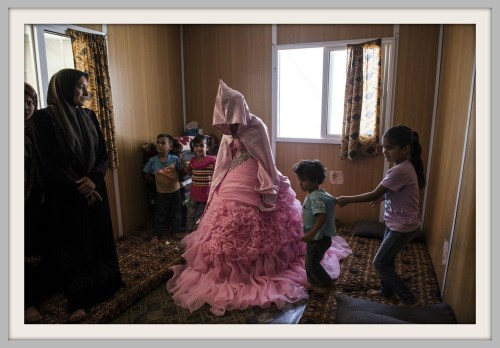 "Lynsey says of this 13-year-old girl, photographed at her engagement party at a camp in Jordan: ""Syrian refugees typically marry young. It's been exacerbated by the war. Families are scared something might happen to their daughter. They prefer to marry them earlier so they're under the protection of a husband."" (Photo/Lynsey Addario for NPR)"