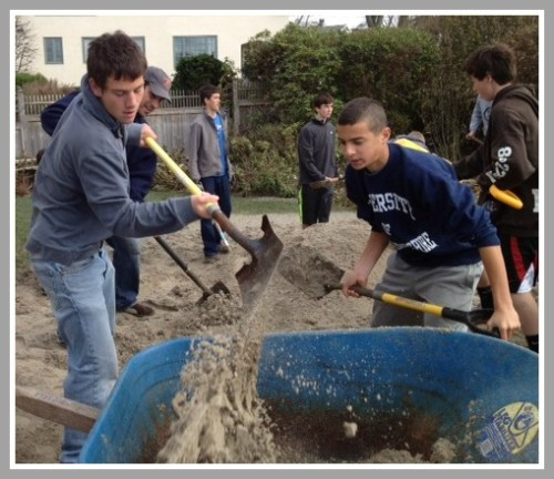 After Hurricane Sandy, Staples soccer players helped clean up sand from front yards on Soundview Drive.