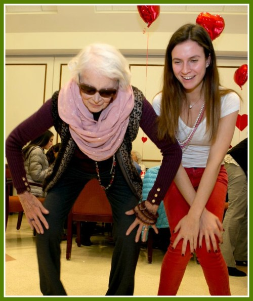 Rita Adams (left) dances with Leah Fuld, at the Valentine's party. (Photo/Susan Woog Wagner)