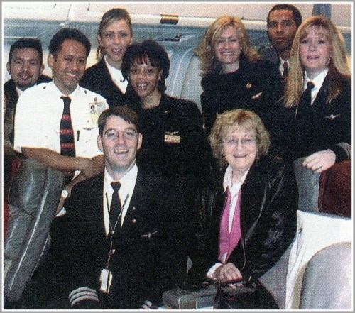 Captain Peggy Lehn (far right), with her brother Tom (front left), their mother Kathleen (far right), and other American Airlines crew members.