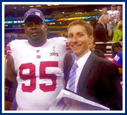 Dan August with New York Giants' defensive tackle Rocky Bernard at the XLVI Super Bowl.