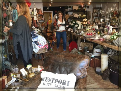 A typical day: a customer browses (left), while Mersene makes sure all is well. Check out the Westport pillows!