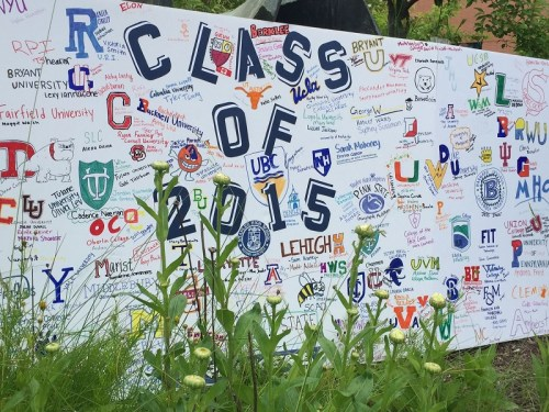 Seniors painted a sign in the courtyard, showing the many places they'll go next.