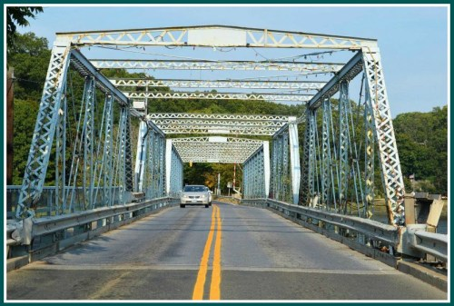 The Bridge Street bridge: While Westporters debate its future, Jackie Hatton turns it into a post-apocalyptic checkpoint into and out of Saugatuck.