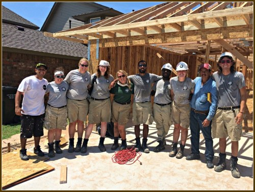 Nellie Stagg (center, in green) with her team. They built Habitat For Humanity homes in Oklahoma.