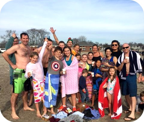 A new tradition: The Compo Beach Christmas Day swim. (Photo/Chip Stephens)