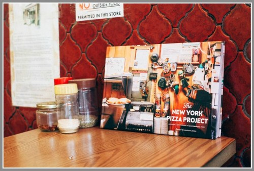 """You can buy """"The New York Pizza Project"""" at many New York pizza joints."""