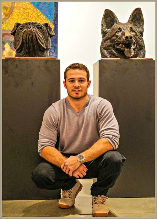 Jesse Nusbaum with 2 of his sculptures at Art Basel Miami last month.