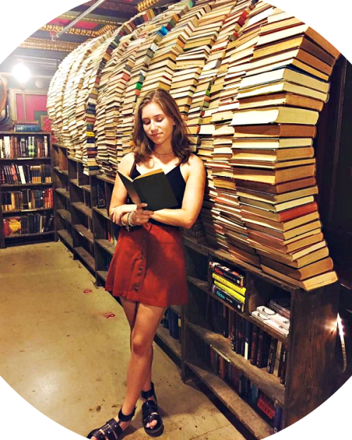 Zoe Brown, browsing at The Last Bookstore.