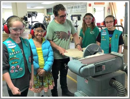 The Girl Scouts of Troop 50889, hard at work on their lily pads seats.