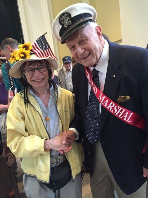 Grand marshal Joe Schachter -- a 90-year-old World War II vet -- poses with a patriotic fan. (Photo/Doris Ghitelman)