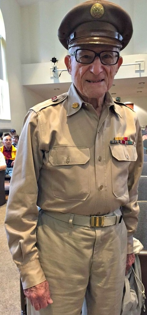 92-year-old Leonard Everett Fisher -- a former grand marshal -- wears his World War Ii uniform proudly.