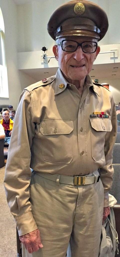 92-year-old Leonard Everett Fisher -- a former grand marshal -- wears his World War Ii uniform proudly.